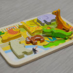 Kids puzzle board with animal shapes
