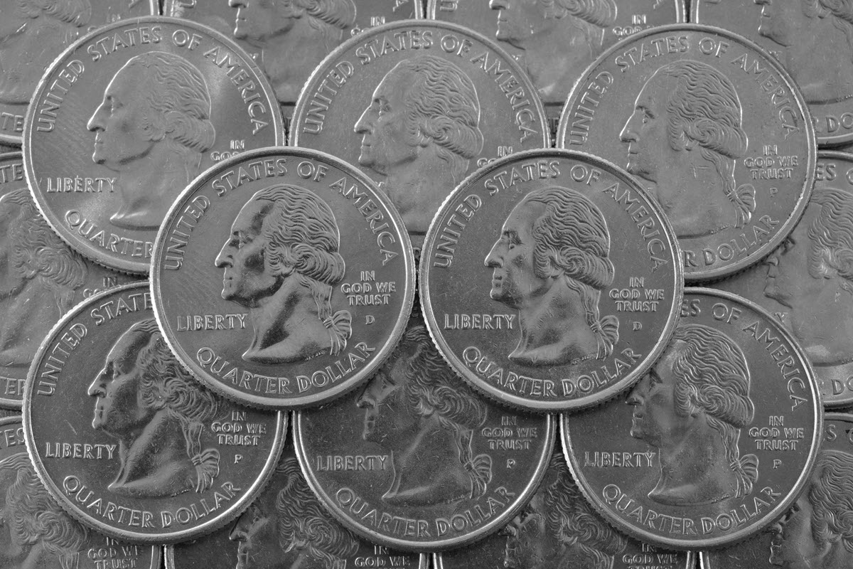 Neat stack of American coins showing president