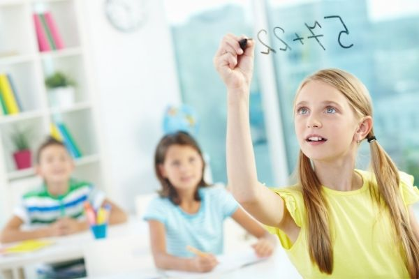 Children learning regrouping using expanded notion