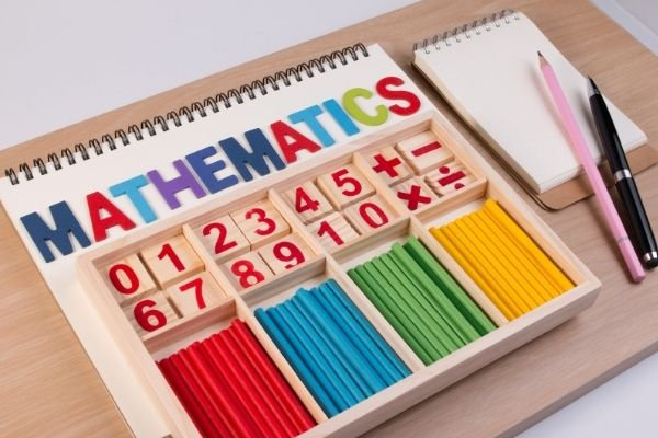 How to teach regrouping using physical objects like colorful wooden sticks, cubes, beads, and drawing